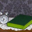 Royalty-Free Stock Photo: Retro alarm clock and green book