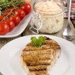 Stock Photo: Loin steak with coleslaw