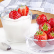 Fresh yogurt with organic strawberries — Stock Photo