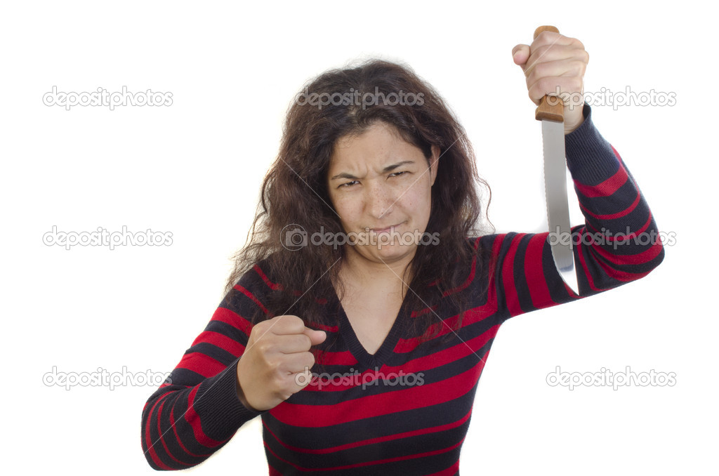 Aggressive young woman with a clenched fist and a large kitchen knife — Stock Photo #10942444