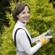 Young woman with garden tool during gardening — Stock Photo #10961695
