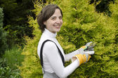 Young woman with garden tool during gardening — Stock Photo