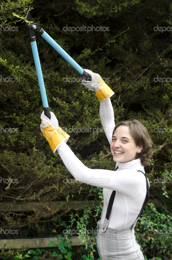 Young woman with working gloves during gardening — Stock Photo #10961634