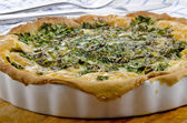Spinach quiche in a porcelain baking form — Stock Photo