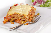 Vegetable lasagna with a fork — Stock Photo