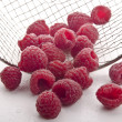 Stock Photo: Freshly picked raspberries were cleaned