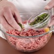 Minced meat and ingredients that are needed to make meat balls - Stock Photo