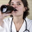 Royalty-Free Stock Photo: Medical Staff Member drinking beer
