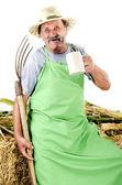 Agriculteur biologique avec une fourche et une chope de bière — Photo