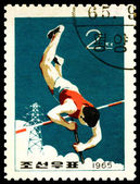 Vintage postzegel. polsstokhoogspringen. — Stockfoto