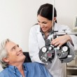 Optometrist And Patient Before Eye Checkup - Stockfoto