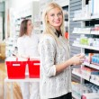 Woman at Pharmacy Store — Stock Photo #10761425
