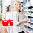 Woman at Pharmacy Store - Stock Photo