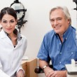 Stock Photo: smiling optometrist with her patient