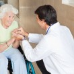 Doctor Comforting Happy Senior Woman — Stock Photo