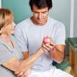 Therapist Giving Muscle Training - Stockfoto