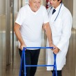 Doctor Assisting Old Man On a Walker — Stock Photo