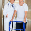 Doctor Assisting Senior Man On a Walker — Stock Photo