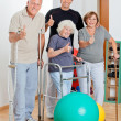 Disabled Senior With Trainer Showing Thumbs Up Sign - Foto Stock
