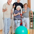 Stock Photo: Disabled Senior With Trainer Showing Thumbs Up Sign