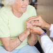 Doctor Comforting Senior Woman — Stock Photo