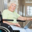 Senior Woman In Wheelchair Using Laptop — Stock Photo