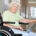 Senior Woman In Wheelchair Using Laptop — Stock Photo