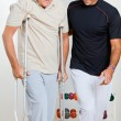 Trainer Helping Senior Man To Walk — Stock Photo #10767249
