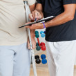 Trainer Holding Clipboard While Standing With Senior Man On Crut — Stock Photo