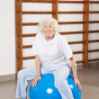 Royalty-Free Stock Photo: Happy Senior Woman Sitting On Fitness Ball