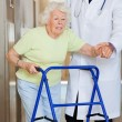 Doctor Showing Way To The Patient Using Walker — Stock Photo #10767475