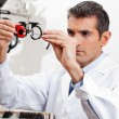 Eye Doctor Checking Lens Of Trial Frames - Stockfoto