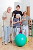 Disabled Senior With Trainer Showing Thumbs Up Sign — Stock Photo