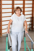 Woman Walking With The Help Of Support Bars — Stock Photo