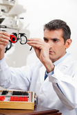 Eye Doctor Checking Lens Of Trial Frames — Stock Photo