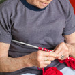 Senior Woman Knitting With Red Wool - Foto Stock