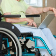 Senior Woman Sitting In Wheelchair Using Laptop — Stock Photo