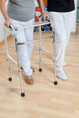 Woman With Walker And Trainer — Stock Photo