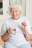 Woman Taking her Medicine — Stock Photo