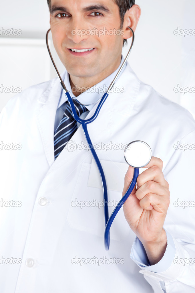 Portrait of male doctor holding stethoscope . — Stock Photo #10871855