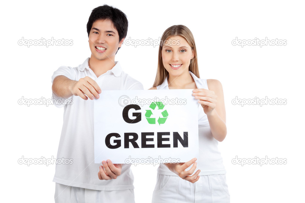 Portrait of young happy couple holding blank placard.  Stock Photo #10872105