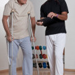 Patient on Crutches and Physician - Zdjęcie stockowe