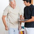 Therapist With Senior Man - Stock Photo