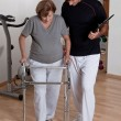 Patient with Walker and Physician — Stock Photo #11203692