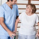 Mature Woman having ambulatory therapy — Stock Photo