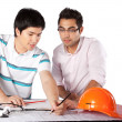 Stock Photo: Two Architects Discussing on Blueprints