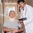 Doctor with Patient in Wheelchair - Stock Photo