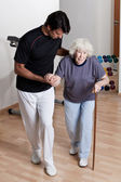 Therapist helping Patient To Walk — Stock Photo