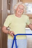 Elderly Woman with Zimmer Frame — Stock Photo