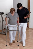 Patient with Walker and Physician — Stock Photo